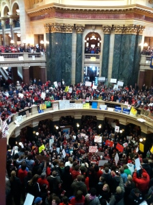 Protesters against Gov Walker's antiunion bill, Wisconsin's capitol rotunda (Image: Joe Rowley via Wikimedia CC BY-SA 3.0)